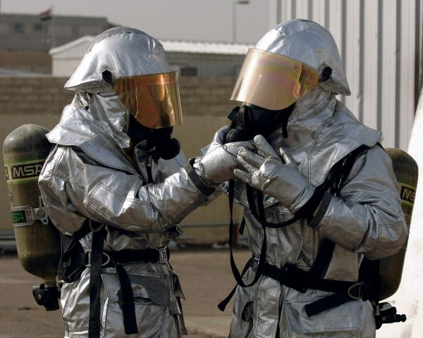 Fire fighters in their silver protective clothing