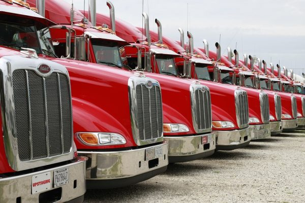 Close up of a row of red lorries