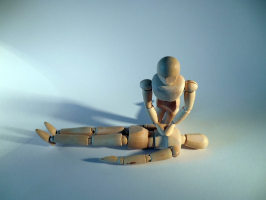 a model doll performing cpr