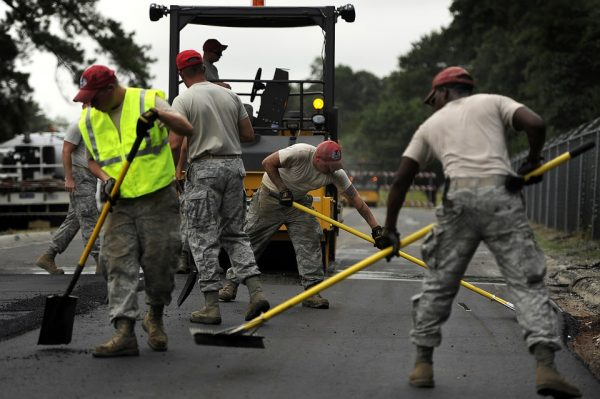 Group of builders working on the road