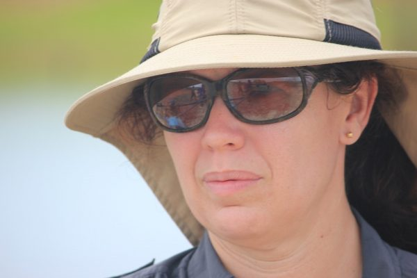 Close up of a woman wearing a hat and sunglasses