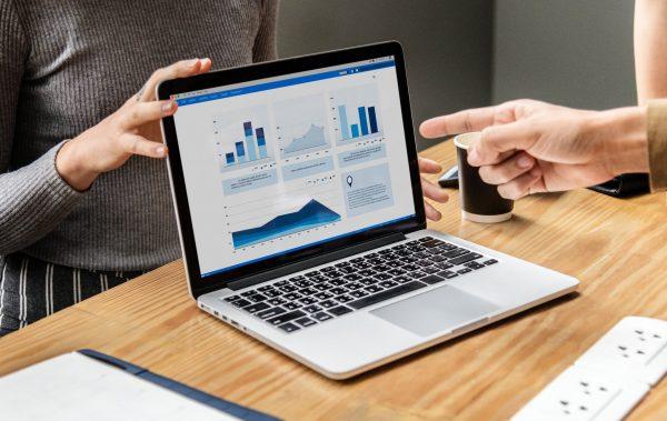 business profit graphs on a laptop