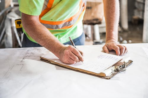 builder signing a form